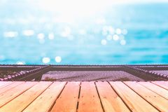 Selective focus of old wood table with beautiful beach background for display your product. Selective focus of old wood table with blur beautiful beach royalty free stock photography