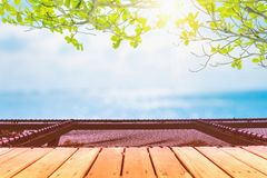 Selective focus of old wood table with beautiful beach background for display your product. Selective focus of old wood table with blur beautiful beach royalty free stock photos