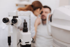 Selective focus of ophthalmological equipment being in use Royalty Free Stock Images