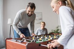 selective focus of parents and kid playing table football together royalty free stock photo