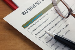 selective focus pen,Business loan application form ,glasses,pape Stock Photo