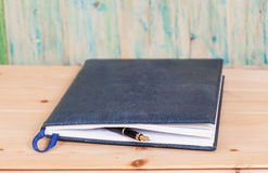 Selective focus of the  pen on opened lined diary book Stock Images