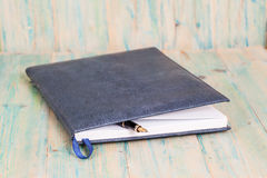 Selective focus of the  pen on opened lined diary book Stock Image