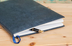 Selective focus of the  pen on opened lined diary book Royalty Free Stock Images