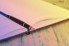 Selective focus of the  pen on opened lined diary Royalty Free Stock Photo
