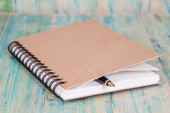 Selective focus of the  pen on opened lined diary Stock Photos