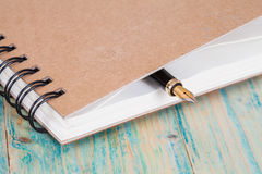 Selective focus of the  pen on opened lined diary Stock Photography