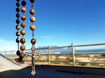Selective Focus Photo of Brown and Silver Rosary Stock Images