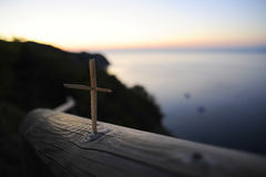 Selective Focus Photo of Brown Wooden Cross Near Body of Water Stock Image