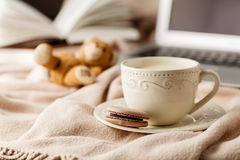 Selective focus photo of cozy knitted scarf with to cup of coffe. E and open book. style retro filtered Royalty Free Stock Photos