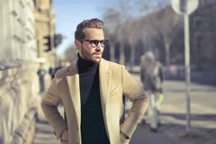 Selective Focus Photo of Man Wearing Black Turtleneck Top With Jacket on Road Stock Photos