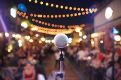 Selective Focus Photo of a Microphone in Front of Audience Royalty Free Stock Photography