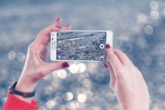 Selective Focus Photo of Person Holds White Samsung Galaxy Note Edge Stock Photography
