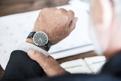 Selective Focus Photo of a Person Wearing Round Watch at 9:36 Stock Images