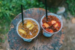 Selective Focus Photo of Two Juice Filled Plastic Cups Stock Images