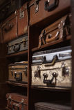 Selective focus photo of vintage suitcases stacked on the shelves Royalty Free Stock Photo
