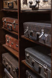 Selective focus photo of vintage suitcases stacked on the shelves Royalty Free Stock Photography