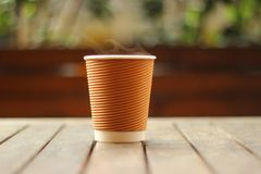 Selective Focus Photo of White and Brown Disposable Cup Royalty Free Stock Photos