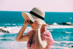 Selective Focus Photo of Woman Wears Beige Sun Hat Stand Behind Body of Water a Daytime Royalty Free Stock Photos