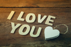 Selective focus photo of The words i love you made with block wooden letters on wooden background Stock Photography