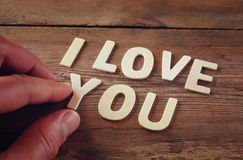 Selective focus photo of The words i love you made with block wooden letters on wooden background Royalty Free Stock Photography