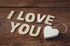 Selective focus photo of The words i love you made with block wooden letters on wooden background Royalty Free Stock Image