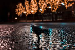Selective Focus Photography of Asphalt Road With Water Droplets Near City Lights during Nighttime Stock Image
