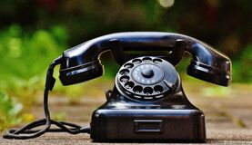Selective Focus Photography of Black Rotary Phone Royalty Free Stock Images