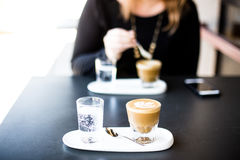 Selective Focus Photography of Blended Caffeine Near Woman About to Stir Coffee Stock Image