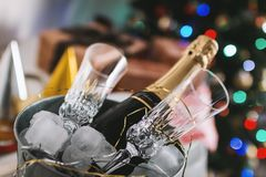 Selective Focus Photography of Brown Labeled Bottle and Two Clear Glass Champagne Flutes Royalty Free Stock Photo