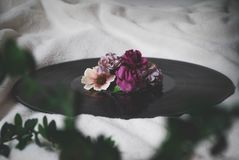 Selective Focus Photography of Flowers On Top of Vinyl Record stock image
