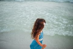 Selective Focus Photography of Girl Standing on Seashore