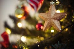 Selective Focus Photography of Gold Star Bauble Stock Photo