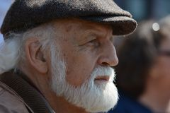 Selective Focus Photography of Man in Flat Cap during Daytime Stock Images