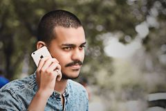 Selective Focus Photography of Man Holding Gold Iphone 6 stock images