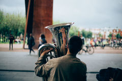 Selective Focus Photography of Man Holding Wind Instrument Royalty Free Stock Photo