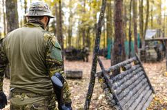 Selective Focus Photography of Man Wearing Camoflouge Suit While Holding a Gun Royalty Free Stock Images