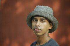 Selective Focus Photography of Man Wearing Gray Fedora Hat and Gray Crew-neck Shirt Royalty Free Stock Image