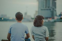 Selective Focus Photography of Man and Woman Watching Body of Water and Concrete Buildings Royalty Free Stock Image