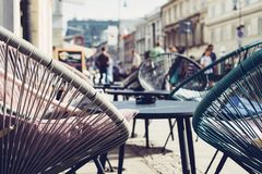 Selective Focus Photography of Patio Set Near Walking People Royalty Free Stock Photos