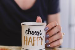 Selective Focus Photography of Person Touch the White Ceramic Mug With Choose Happy Graphic royalty free stock images
