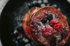 Selective Focus Photography of Raspberry and Blueberry Pancakes Stock Photography
