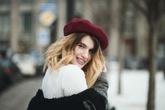 Selective Focus Photography of Smiling Woman Wearing Red Hat during Snowy Day royalty free stock photography