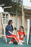 Selective Focus Photography of Two Women Sitting on Tennis Court Royalty Free Stock Photography