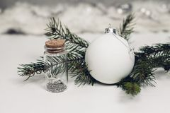 Selective Focus Photography of White Christmas Bauble Beside Bottle With Cork Lid Stock Image