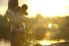 Selective Focus Photography of Woman Carrying Baby Royalty Free Stock Image