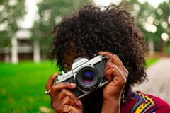 Selective Focus Photography of Woman Holding Camera stock photography