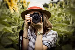 Selective Focus Photography of Woman Holding Dslr Camera royalty free stock photo