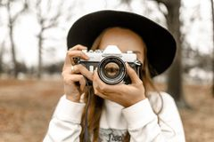 Selective Focus Photography of Woman Using White and Black Slr Camera Stock Photo