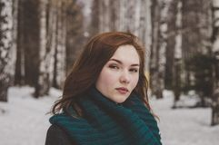 Selective Focus Photography of Woman Wearing Blue Scarf While Standing on Snow Covered Forest royalty free stock images